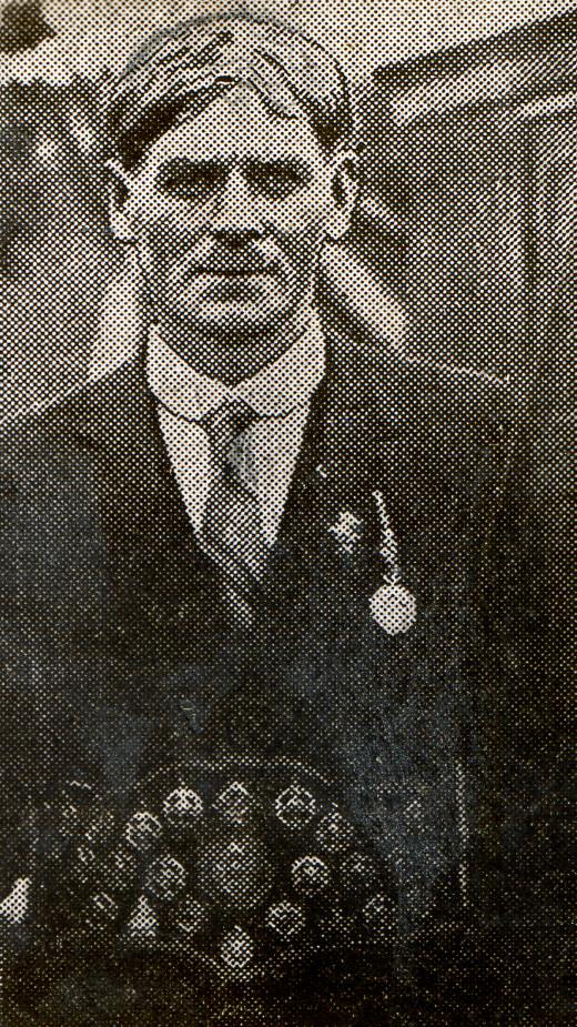 Tim Crowe wearing his medal belt.